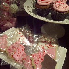 Pink sweet table with cupcakes, sugar cookies and cake pops