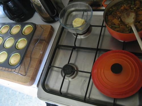 Buns cooling, butter softening, squash & bean casserole simmering
