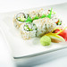 Imitation crabmeat, sliced avocado, sliced cucumber. The Deluxe California Rolls are topped with masago roe.
