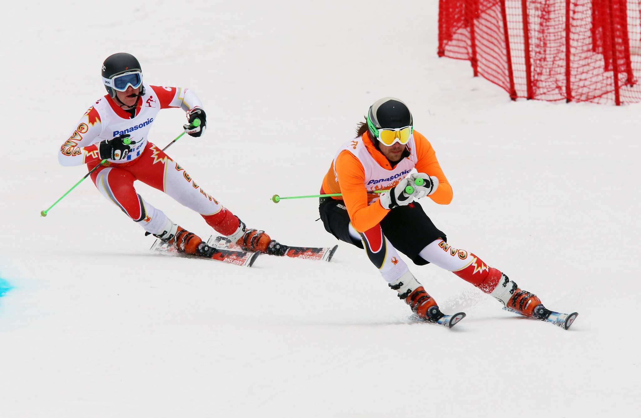 Robin Femy guides Mac Marcoux to the top of the podium during the giant slalom at the 2014 Paralympic Winter Games in Sochi, RUS