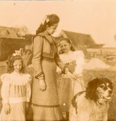 Girls with a dog.