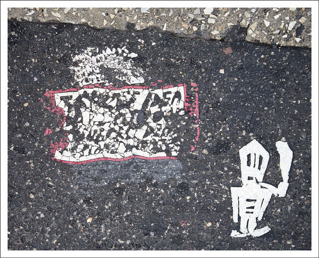 Two Toynbee Tiles and Stick Man 12th and Market