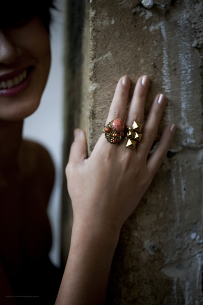 From left: 1960s West Germany beaded gold-toned ring with a coral stone; 1960s faceted gold-toned ring