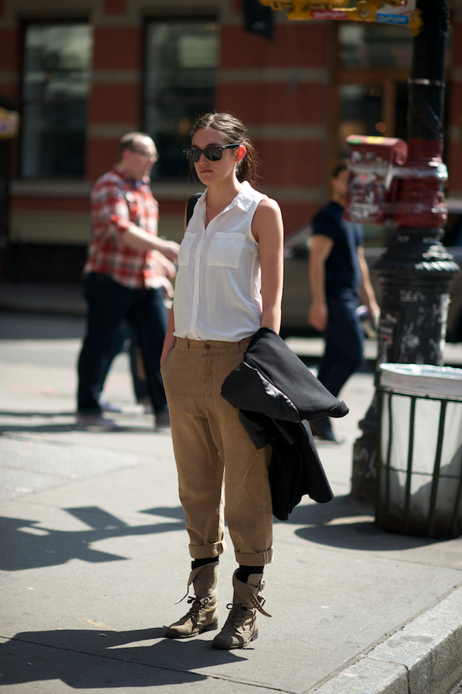 Girl wearing All Saints Damisi boots and Ray Ban Wayfarers