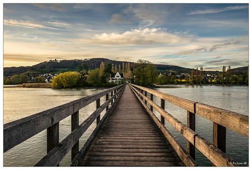 light sky sun clouds landscape schweiz switzerland see sonnenuntergang wolken sigma brücke fluss sonne rhein steg landschaften abendsonne steinamrhein thurgau eschenz inselwerd