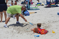 Helping to bury a kid at Surfers For #Autism: Returns to Treasure Island, Florida on 7 July 2012