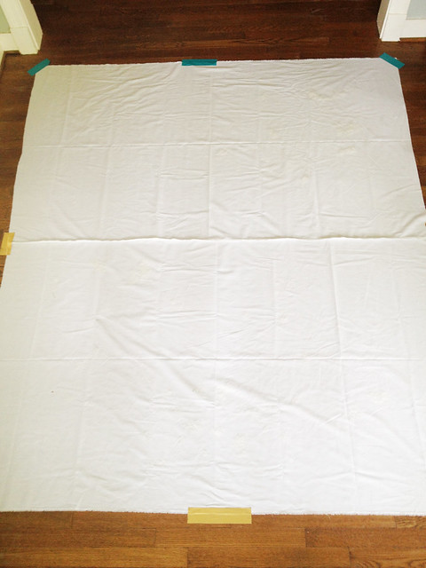 first layer of quilt onthe ground with duct tape