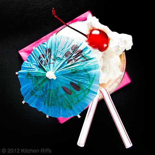 Root Beer Float with Cherry Garnish and Cocktail Umbrella, Overhead View