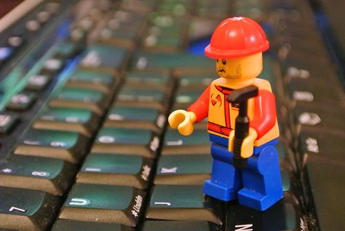 Lego chap fixing computer