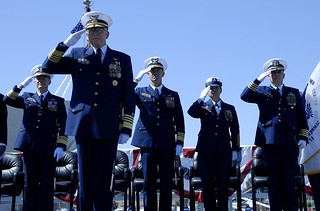 Adm. Robert J. Papp, Commandant of the Coast Guard, and the official party render salutes during the opening of the Change of Command Ceremony held on Coast Guard Island in Alameda, Calif., April 22, 2014. Vice Adm. Charles W. Ray assumed command from Vice Adm. Paul F. Zukunft as commander of Coast Guard Pacific Area. Coast Guard photo by Petty Officer 3rd Class Loumania Stewart