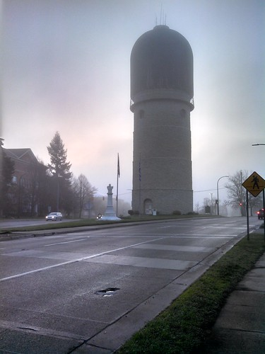 road street morning mist building rain fog architecture sunrise watertower overcast historic sidewalk bust hazy crosswalk