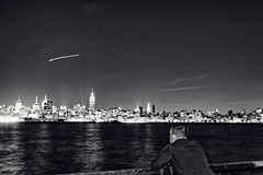 A self portrait and the New York skyline at night