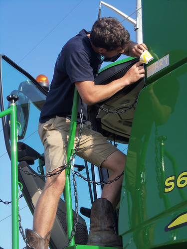Oak helps put our decals on our new combines