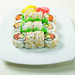 Spicy fish salad - tuna, shrimp, salmon - with sliced cucumbers and topped with spicy mayonnaise sauce.