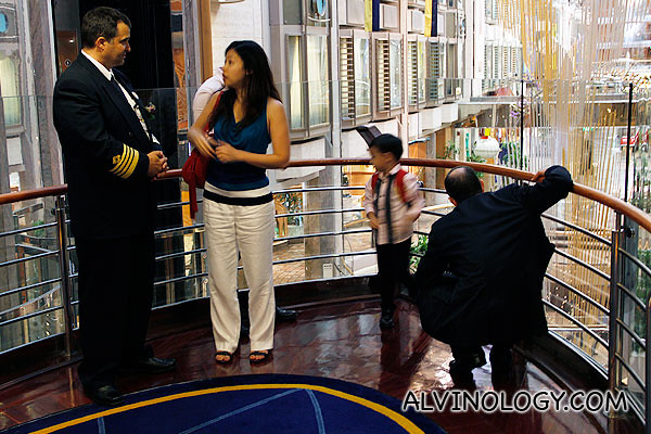 This little boy and her parents are the first passengers to board the ship from Singapore