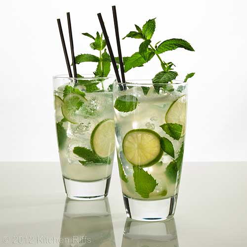 Two Mojito Cocktails with Mint Garnish and Straws, White Background
