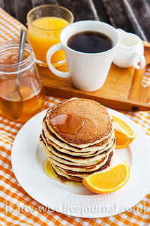 Breakfast with orange pancakes
