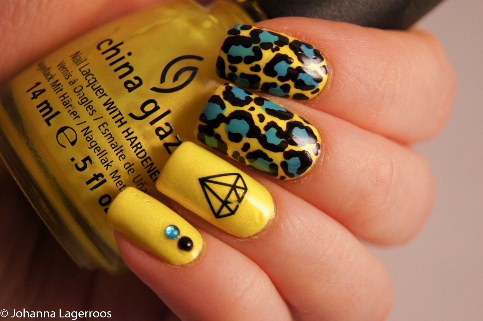 yellow leopard nails