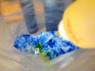 Yellow dye squirting out onto the fabric (inside the bag)