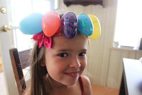 child wearing an Easter egg crown