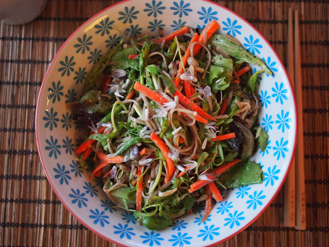 Tahini sauce cold soba noodles with loads of veggies and chives blossom