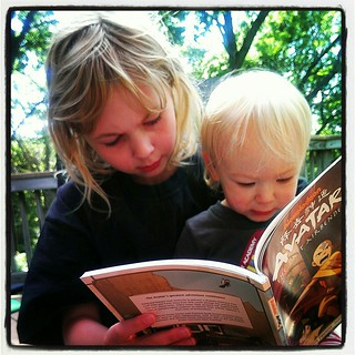 geeklings reading on the deck