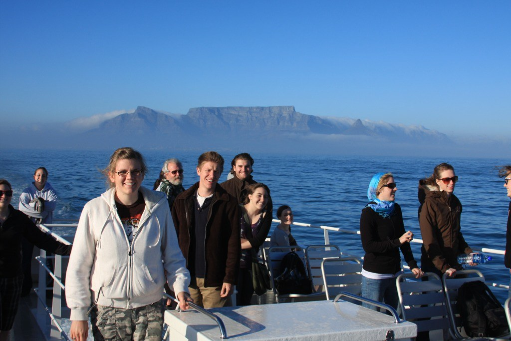 NAU Shrine of the Ages Choir and the Master Chorale of Flagstaff on a boat from Cape Town to Robben Island with Table Mountain in the background