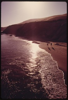 Two people have a portion of Gaviota State Beach, all to themselves, June 1975