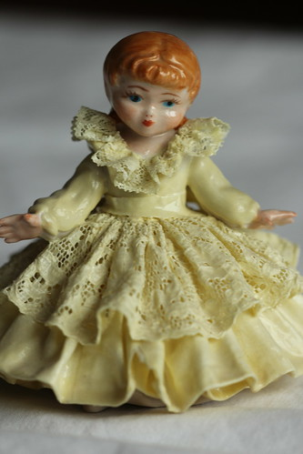Ceramic doll with ceramic lace dress