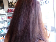 Chocolate Brown all over hair color with subtle red highlights