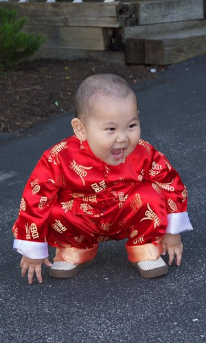 Happy baby squatting