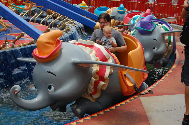 Rob and George getting into Dumbo's ride.