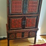Antique Asian armoire in sleeping area