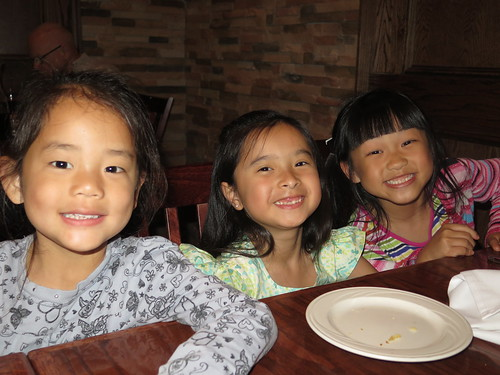 Amelie, Rieley and Nadia at dinner.