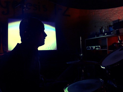 Ben Always Records Drums in Silhouette