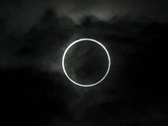 symbol(0.0), event(0.0), crescent(0.0), moon(1.0), celestial event(1.0), eclipse(1.0), corona(1.0), circle(1.0), monochrome(1.0), darkness(1.0), black-and-white(1.0),