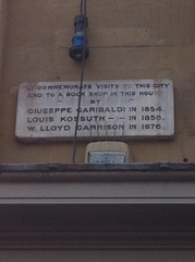 Photo of Giuseppe Garibaldi, Louis Kossuth, and William Lloyd Garrison stone plaque