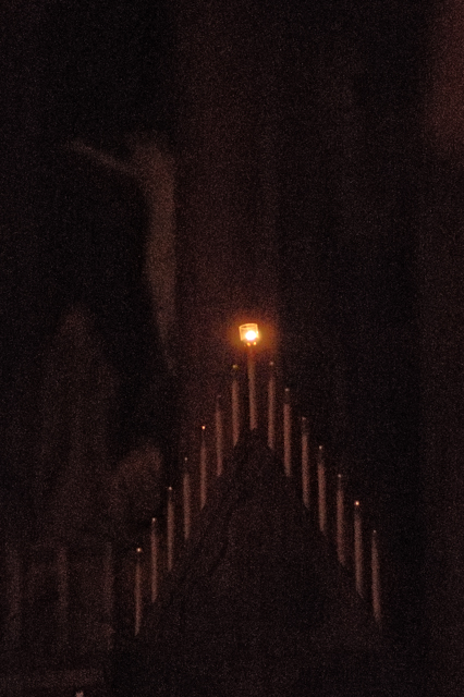 Cathedral Basilica of Saint Louis, in Saint Louis, Missouri, USA - single candle on hearse illumining sanctuary