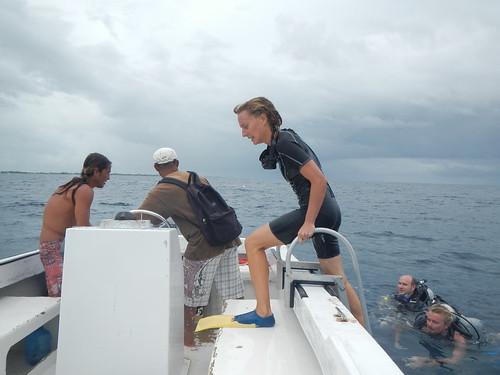 Diver steps into boat after dive