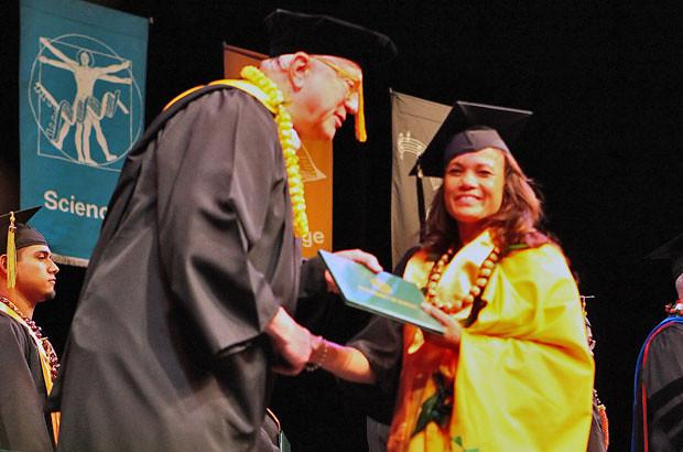 <p>Windward CC Chancellor Douglas Dykstra congratulates Hannah Carroll, one of the campus' 207 graduates (photo by Bonnie Beatson)</p>