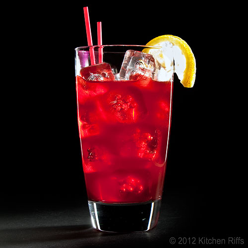 Sloe Gin Fizz with Lemon Garnish & Straws, Black Background