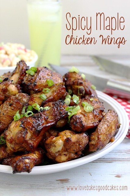 Spicy Maple Chicken Wings piled high on a plate.