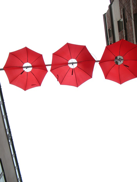 Free Red Silhouette of an Umbrella Clipart Picture