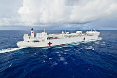 In this file photo, USNS Mercy (T-AH 19), lead vessel for Pacific Partnership 2012, transits through the Pacific Ocean, May 18. (U.S. Navy photo by Mass Communication Specialist 3rd Class Michael Feddersen)