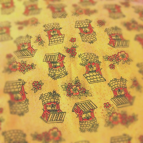 Look at this adorable wishing well feed sack fabric I got at ICE today!