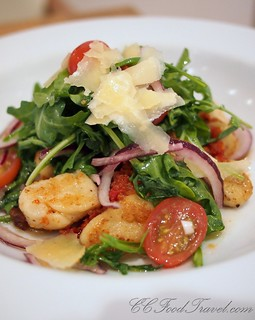 Red pesto gnocchi with tomato and arugula salad