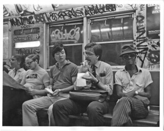 My dad eating a hotdog on a subway circa 1983