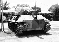 armored car(0.0), military(0.0), army(1.0), combat vehicle(1.0), military vehicle(1.0), weapon(1.0), vehicle(1.0), tank(1.0), self-propelled artillery(1.0), gun turret(1.0), churchill tank(1.0), cannon(1.0), monochrome(1.0), black-and-white(1.0),