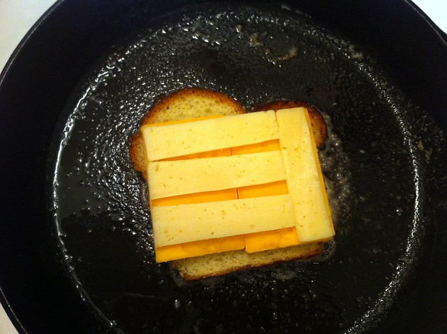 Sliced Swiss Cheese On Top of Cheddar