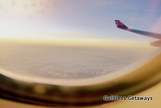 airasia-flight-window-view-above-clouds.jpg